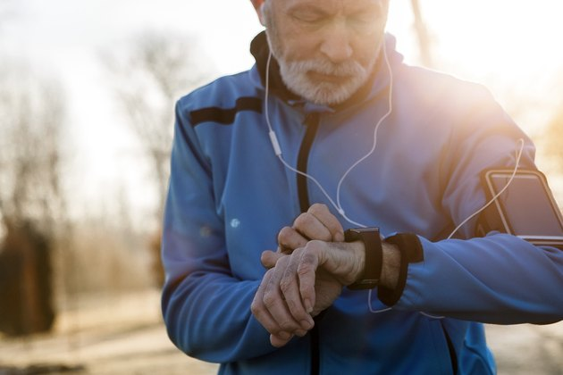 Senior Man using Smart Watch measuring heart rate