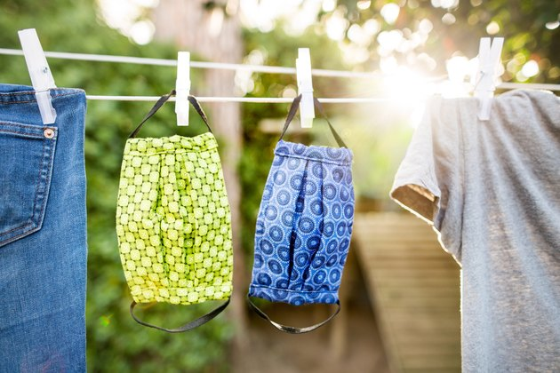 Washable cloth face masks drying on clothes line