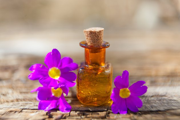 primrose essential oil in  beautiful bottle on table