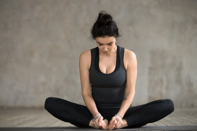 Young woman doing Butterfly exercise