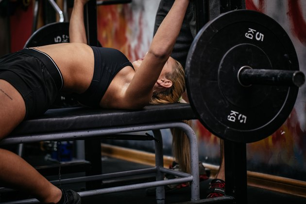 Woman bench press exercise