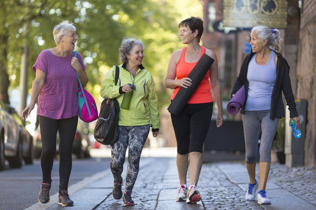 women going for a walk downtown to get all the benefits of walking