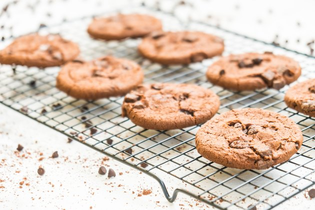 Chocolate Chip Cookies On Cooling Rack At Table