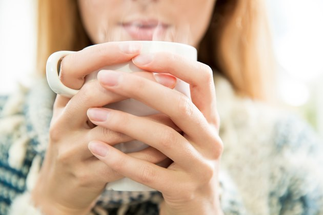 Woman drinking onion tea for cold