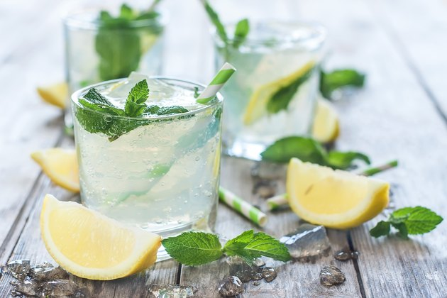 Chilled mint lemonade and carbonated water background
