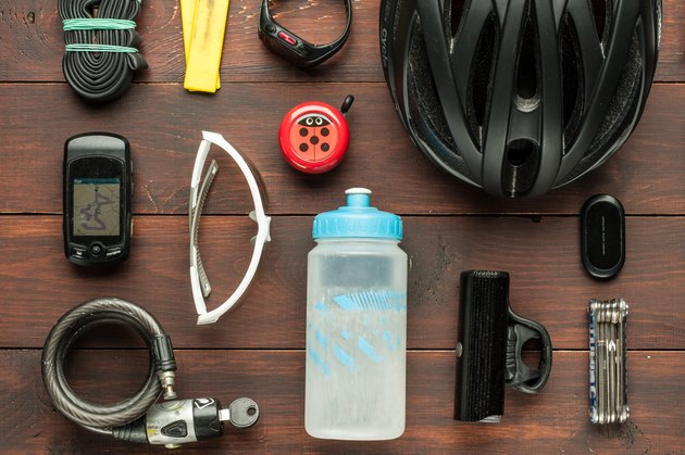 Cycling gear and accessories on wooden table