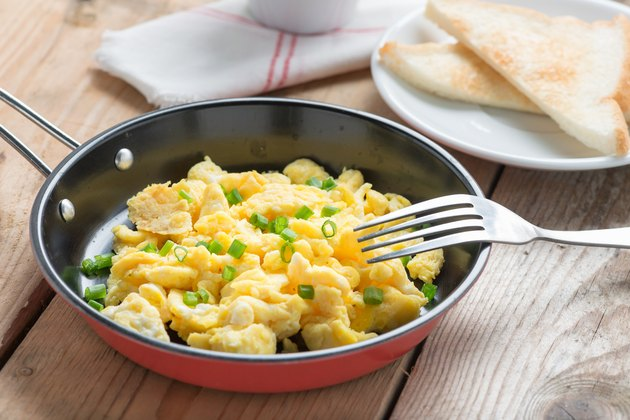 Scrambled egg served in a pan with toast