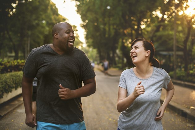A couple running together in the park to prevent high blood pressure