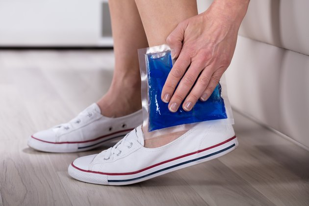 Person Applying Ice Bag On Ankle