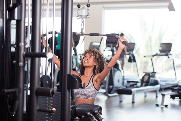 Woman exercising lat pulldown. Back and lat workout.