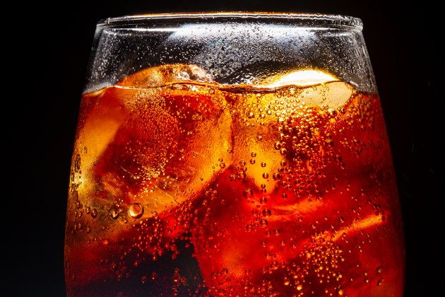 Background of cola with ice and bubbles. Side view background of refreshing cola flavored soda with carbonated with vintage tone