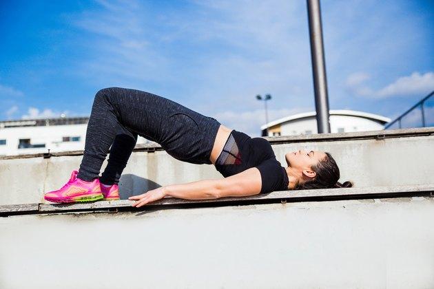 Sporty woman doing  Bridge exercise