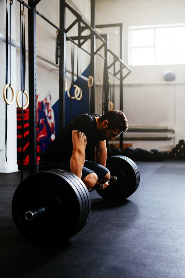 Tired athlete after deadlift exercise
