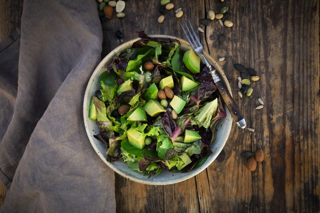 Salad with avocado, almonds and soy beans and seed for healthy hair
