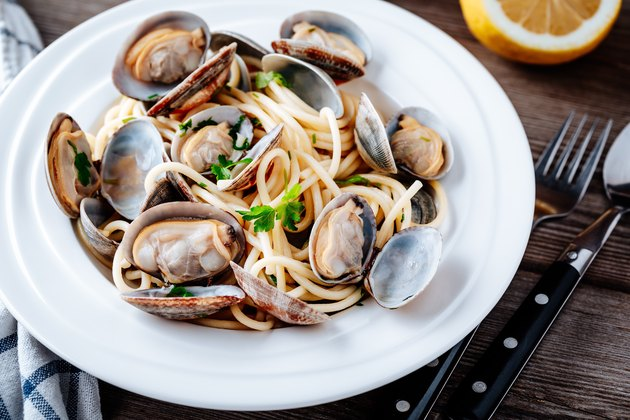 A bowl of traditional Italian seafood pasta with clams