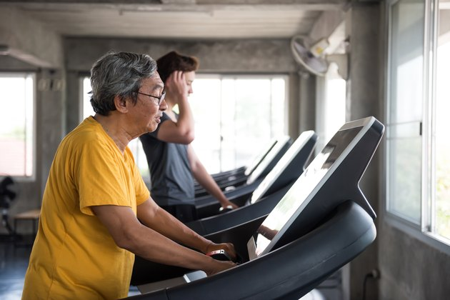 Older man doing beginner cardio workout on the treadmill