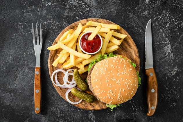 Beef burger, french fries, pickles, onion and ketchup