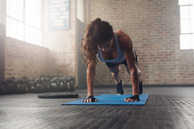 Young muscular woman doing core exercise