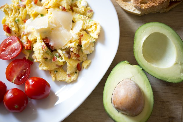 Healthy breakfast with  scramble eggs, vegetables and avocado
