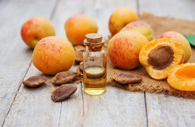 apricot oil in a small jar. selective focus.