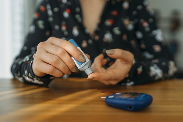 person with diabetes doing blood glucose measurement