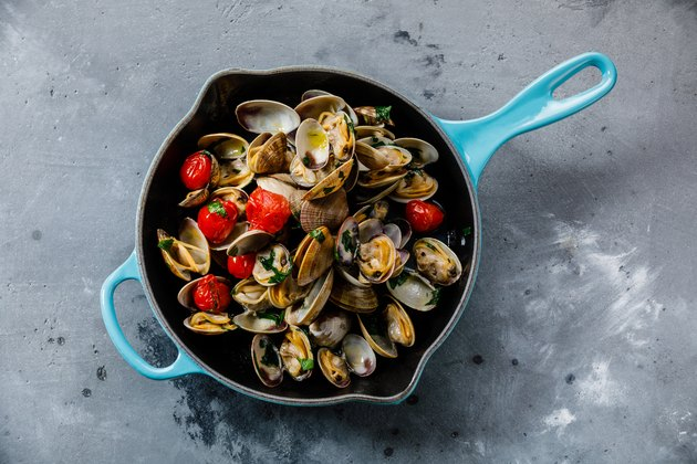Vongole Seafood Clams with tomatoes and parsley in frying cooking pan