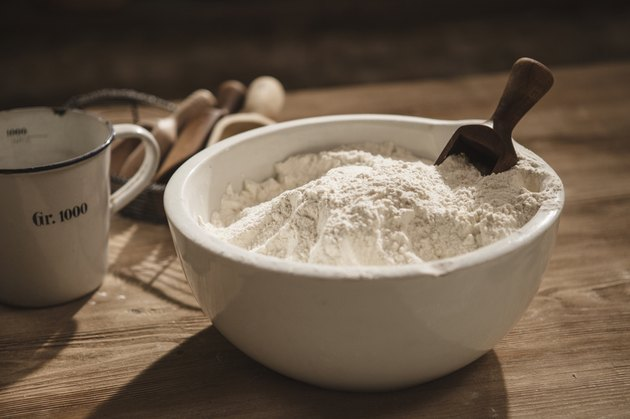 Close up of bowl of flour with scoop