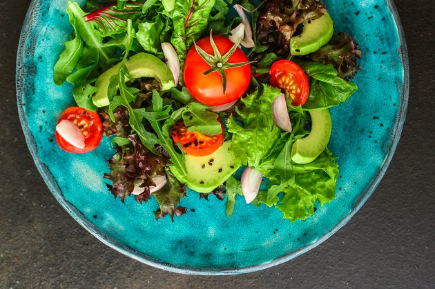 salad healthy, vegetables (avocado, tomato, mix leaves, arugula, lettuce, onions and more) top menu concept. food background. copy space