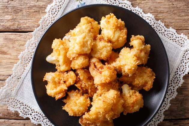 fried cauliflower in breading close-up. Horizontal top view