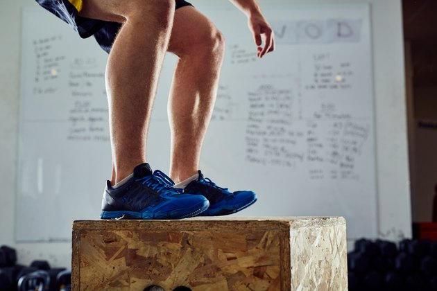 Closeup of man doing box jump exercise