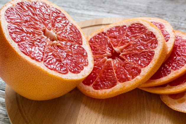 Grapefruit sliced on cutting board to consider grapefruit nutrition