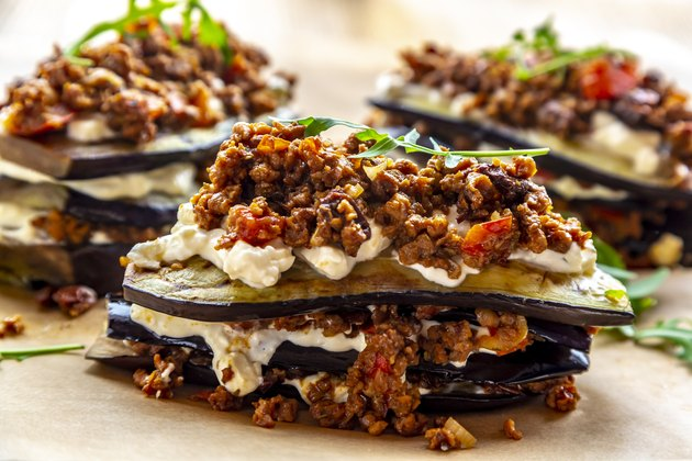 Aubergine lasagna on baking paper, vegetarian
