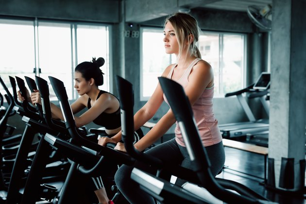 Women Group Doing Workout Cycling Exercise in Fitness Club, Portrait of Pretty Attractive Caucasian Woman Cycling Training in Gym, Beautiful Girl in Sportswear With Smiling While Workout