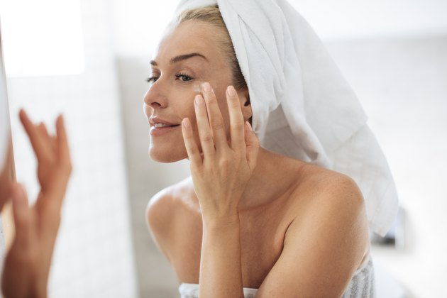 Woman Applying Creme on Face