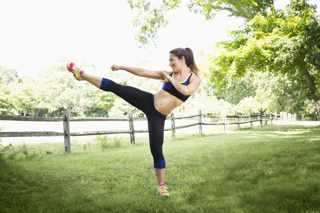 Woman doing a kickboxing workout outside