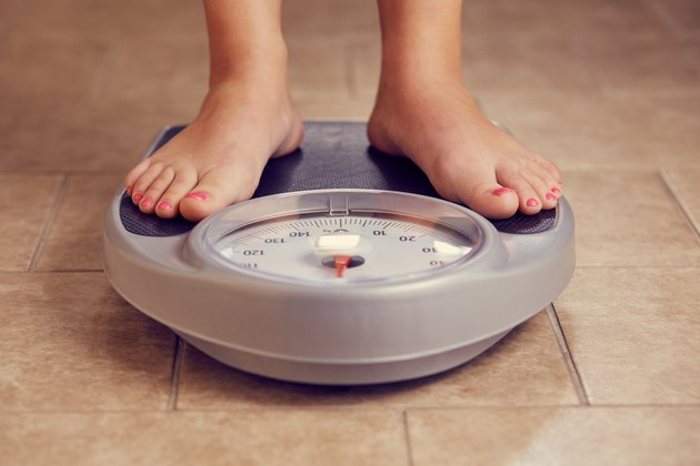 Female feet on a bathroom scale