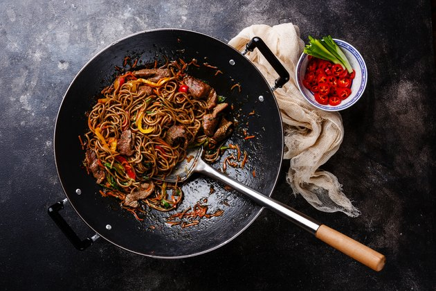 Stir-fry soba noodles with beef and vegetables and cooking oil