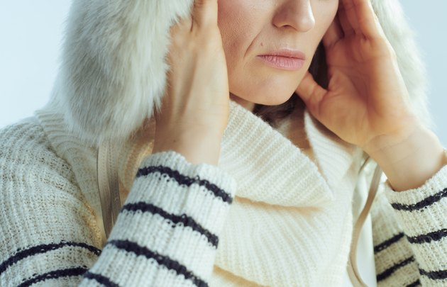 Closeup on stressed woman against winter light blue background