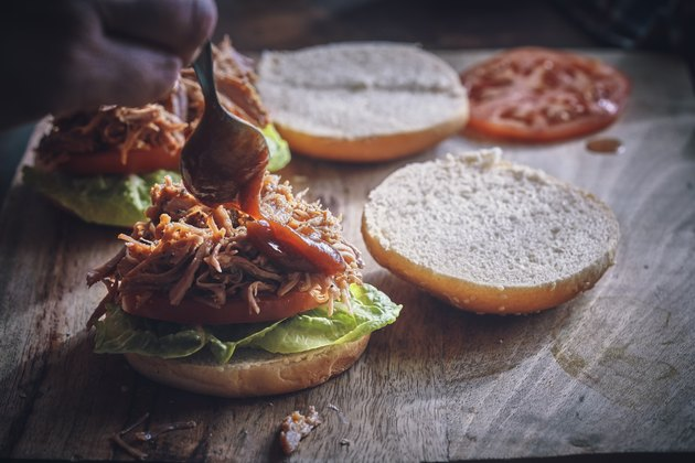 Pulled pork sandwich with tomato, lettuce and gluten-free BBQ sauce