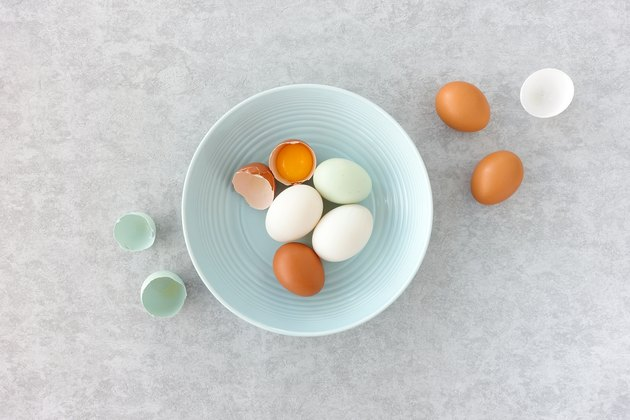 White Duck Eggs in a Blue Bowl