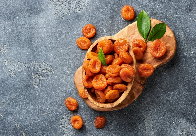 Dried apricots on gray background. Copy space for text. Top view.