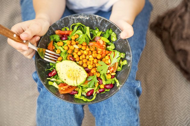 lean eating, vegan healthy salad bowl , top view of woman holding salad bowl, plant based healthy diet with greens, salad, chickpeas and vegetables