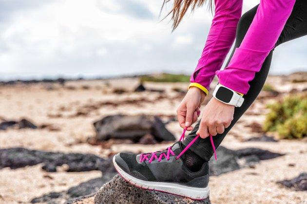 Fitness smartwatch woman runner getting run ready