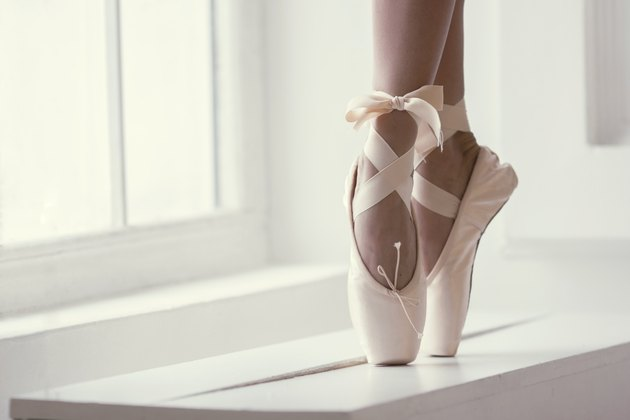 Legs of a ballerina in pointe