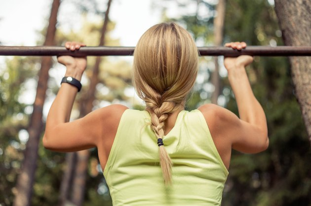 Fit woman doing pull-ups