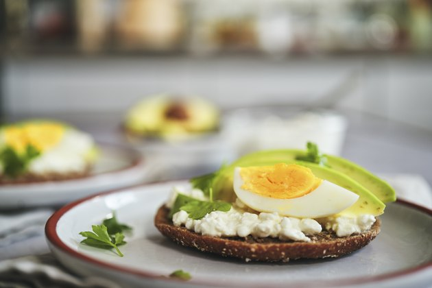 Preparing Avocado Sandwich with Brown Bread, Cottage Cheese and Eggs