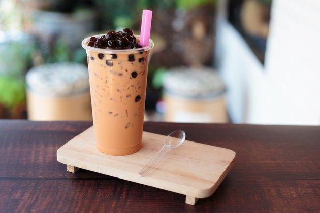 Ice bubble milk tea in takeaway glass