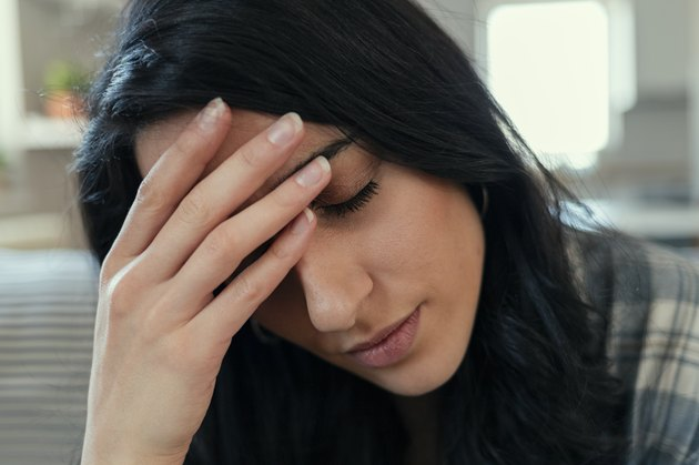 Woman at Home Suffering Migraine