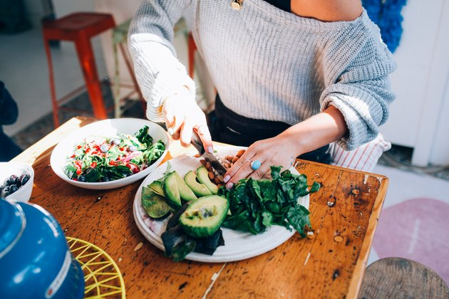 Woman knows how to get more fiber in diet by making salad