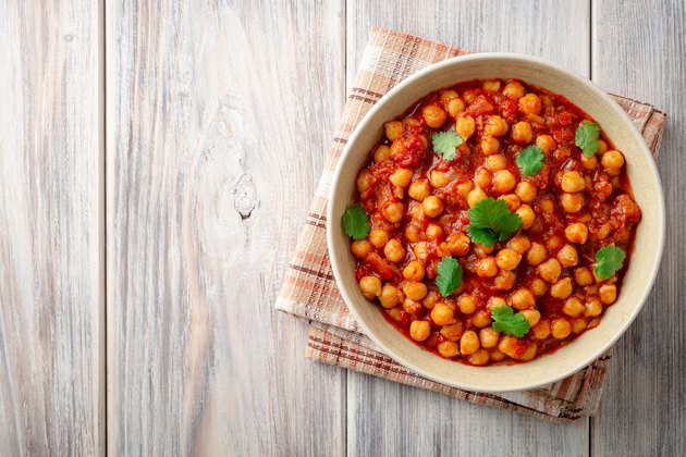 Spicy Chickpea curry Chana Masala in bowl on wooden table
